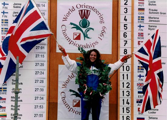 Yvette Bake on podium with British flags